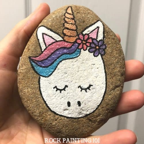 Unicorn rocks. How to draw a unicorn on a rock. Step by step instructions for this fun rock painting project!