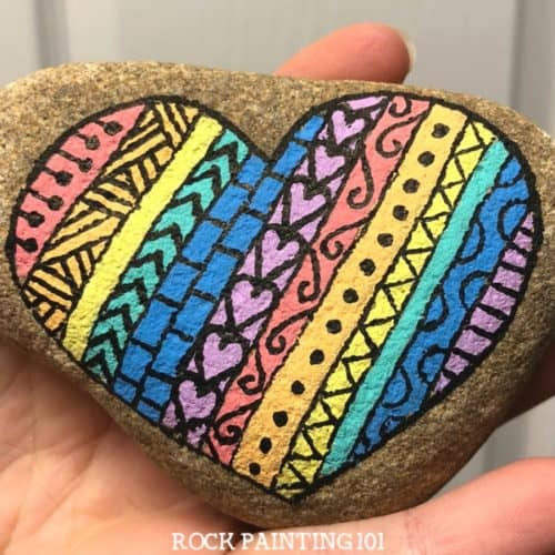 Create striped heart rocks with fun designs in them. Create rock painting project for beginners.
