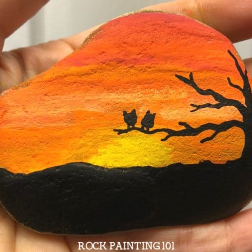 This bright orange sunset rock has a lovely tree silhouette and two fun owls.