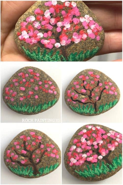 Apple Blossom Dot Painted Rock. #springrock #appleblossom #cherryblossom #dotpainting #rockpaintingideas #stonepainting #paintedrock #stepbystepguide #rockpainting101