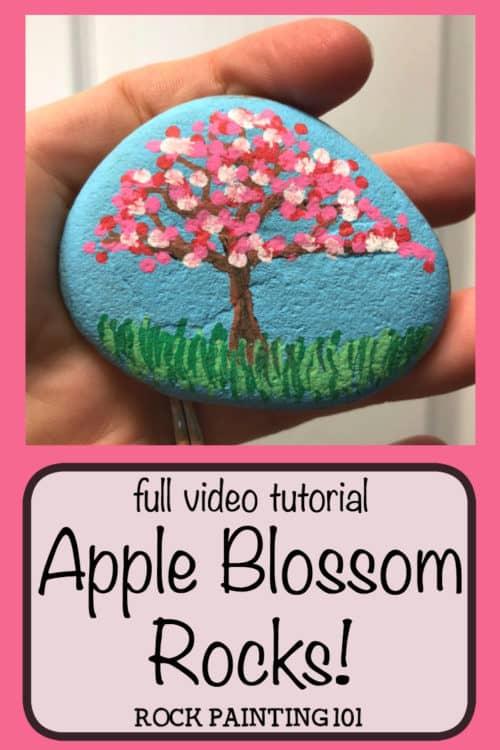Apple Blossom Dot Painted Rock. #springrock #appleblossom #cherryblossom #dotpainting #rockpaintingideas #stonepainting #paintedrock #rockpainting101
