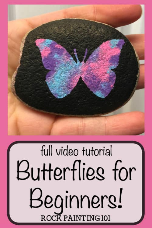 Create beautiful butterfly rocks with this simple technique. From the marbled backdrop to the perfectly symmetrical butterfly, these rock painting techniques are perfect for the beginner. #butterflyrocks #howtopaintabutterfly #howtomarbleonrocks #poscapaintpens #poscapens #howtopaintrocks #rockpaintingideas #rockpaintingforbeginners #rockpaintin101