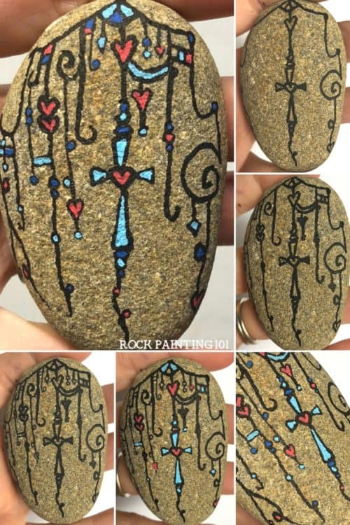 Dangle Art Cross Rocks ~ Beautiful Christian rock painting ideas. Use zendangle technique to create a rock with a cross. #crossrock #christianrockpaintingideas #dangleart #danglecross #zendangle #easterrock