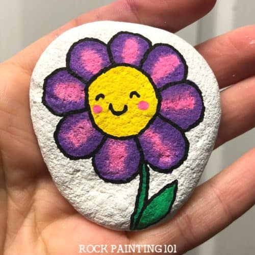 These happy flower rocks are an easy flower painting idea that works perfectly on rocks! I can just imagine the smile on someones face when they find this fun stone painting idea.