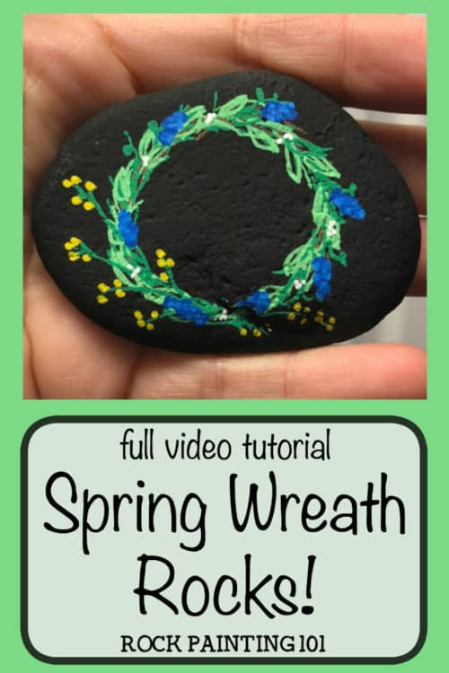 This spring wreath painted rock is a fun and simple! Check out how to draw a wreath with paint pens and be amazed at how simple this stone painting idea is! #springwreath #paintedrocks #springrocks #howtodrawawreath #rockpaintingideasforspring #stonepaintingforbeginners #rockpainting101