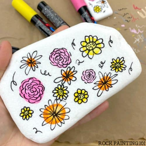 Simple flowers painted onto a rock.