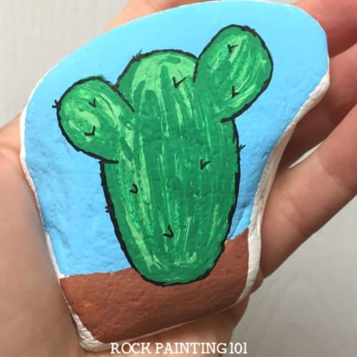 Learn how to paint a cactus on rocks with this simple video tutorial. Grab your paint pens or your favorite paint brush and let's dig into this fun stone painting idea.