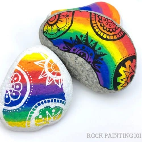 Mandala Rainbow Rocks. These rainbow rock painting ideas are perfect for brightening up someone's day! Each rainbow has a tutorial and is perfect for beginners. #rockpainting101