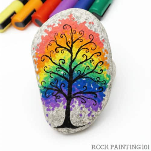 These rainbow rock painting ideas are perfect for brightening up someone's day! Each rainbow has a tutorial and is perfect for beginners. #rockpainting101