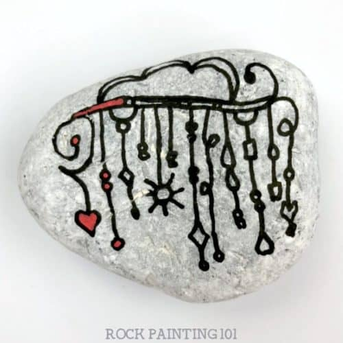 We are loving thisrainbow zendanglepainted rock! Let the colors of the rainbow dangle to create this beautiful and fun rock painting idea. #zendangle #rainbow #dangles #howtopaintrocks #howtozendangle #rainbowrocks #rockpainting #stonepainting #rockpainting101
