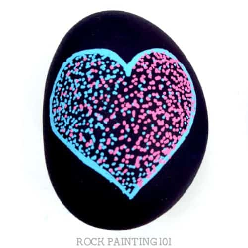 This easy pointillism tutorial is perfect for rock painting beginners. We used this art technique to create a heart rock, but you can paint any shape you want! #pointillism #heart #rockpainting #art #rockart #heartrock #stonepainting #rockpainting101