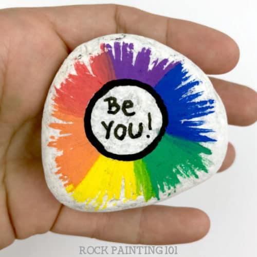 Make a beautiful radial rainbowpainted rocks. Perfect for painting kindness rocks or giving as gifts! #rainbow #kindnessrocks #beyou #radial #howtopaintrocks #rockpaintingideas #stonepainting #rockpainting101