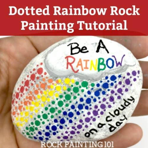 This fundotted rainbow rock is perfect for beginners and makes a fun kindness rock painting idea! #rainbow #rockpainting #kindnessrocks #bearainbow #howtopaintrocks #rockpaintingideas #stonepainting #paintedrocks #rockart #rockpainting101