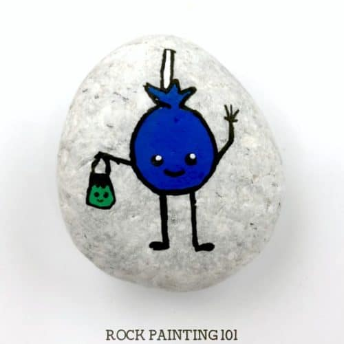 Learn how to paint a lollipop on rocks with this simple tutorial. Grab your paint pens or your favorite paint brush and let's enjoy this fun Halloween rock painting idea. #halloweenrockpainting #rockpaintingideas #lollipop #sucker #trickortreat #halloweenart #cutehalloweenpaintedrocks #stonepainting #halloweenstones #rockpainting101