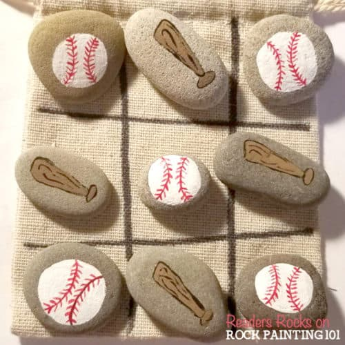 Maketic tac toe rocks that are the perfect boredom buster for kids. They also make amazing gifts! Check out the video tutorial and a collection of ideas for your set. #tictactoe #rocks #travelgame #rockpaintingideas #rockgames #rockgifts #baseball #rockpainting101