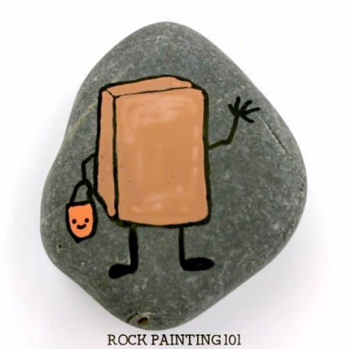 Paint this fun chocolate bar painted rockand you'll have another adorable Halloween trick-or-treater rock. And you'll learn how to draw a fun piece of candy. #chocolatebar #rockpainting #stonepainting #howtodraw #trickortreat #happyhalloween #funrocks #rockpainting101