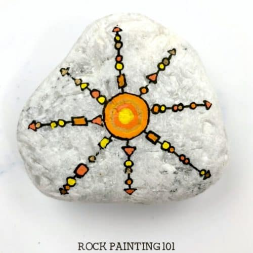 This unique sun zendangle rock painting idea gives a fun twist to the standard vertical dangle technique. Give it a try! #sunrocks #zendangle #dangles #howtopaintrocks #uniquerockpaintingidea #stonepainting #rockart #rockpainting101