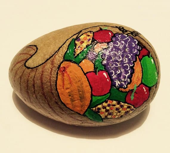 This cornucopia painted rock is perfect for Thanksgiving.
