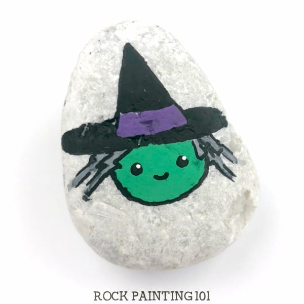 This witch is a fun Halloween rock painting idea.