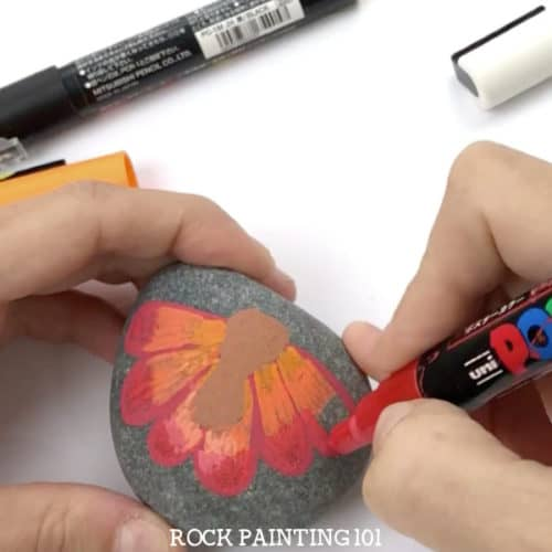 Paint a turkey onto a rock for a fun Thanksgiving rock painting idea. These rocks will look perfect on your Thanksgiving table or hiding around your city! #turkeyrocks #turkeypaintedrock #thanksgivingrock #fallpaintedrocks #howtopaintaturkey #thanksgivingdinnertable #rockpainting101