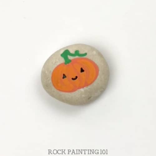 These simple pumpkin rocks are quick to create and perfect for decorating this fall. Use them to spread kindness or to decorate your Thanksgiving table. #pumpkinrocks #fallrocks #thanksgivingrocks #paintedrocks #quickrocks #5minuterocks #howtopaintrocks #howtodrawapumpkin #rockpainting101