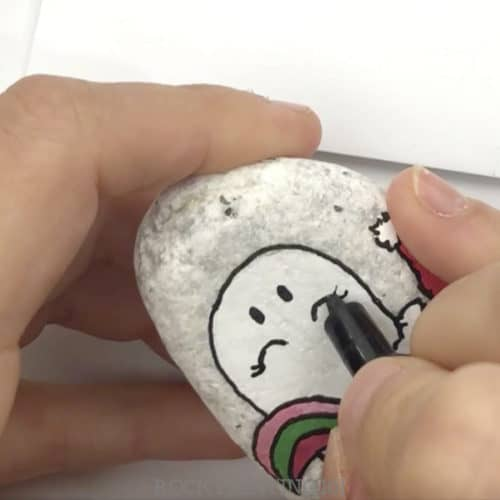 This Christmas unicorn painted rock is perfect for giving this holiday season. Watch the tutorial and see just how easy it is to paint. #christmas #unicornrocks #paintedrocks #videotutorial #stockingstuffer #iloveunicorns #rockgifts #howtodrawaunicorn #rockpainting101