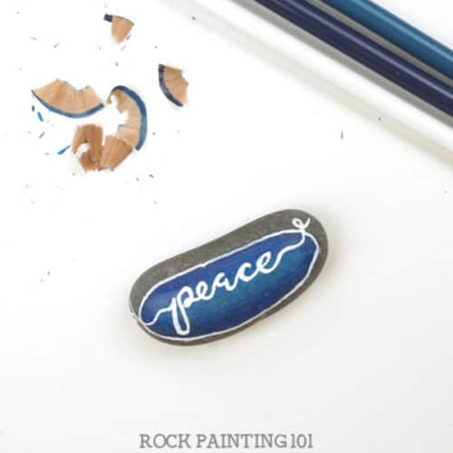 Did you know that you can use colored pencils to paint rocks? This inexpensive and versatile craft supply is perfect for created blended base coats and a smooth surface for hand lettering. #basecoat #coloredpencils #howtopaintrocks #rockpaintingsupplies #rockpainting #forbeginners #rockpainting101