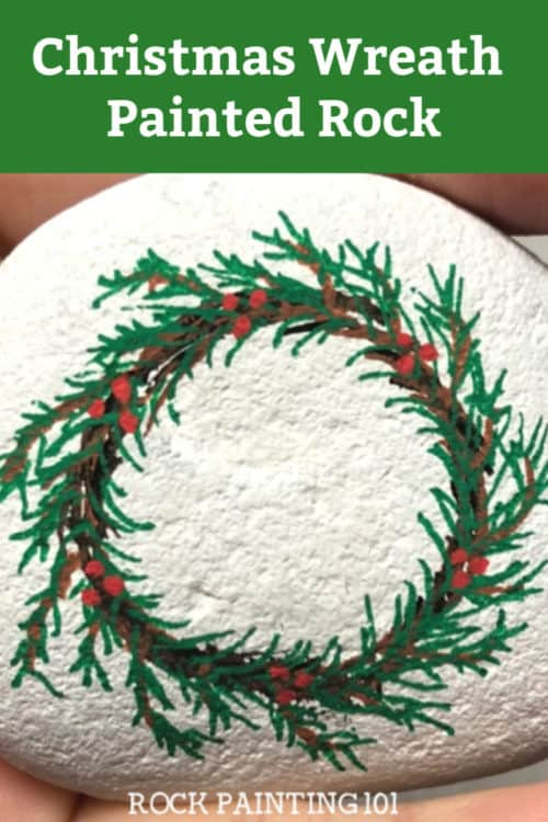 This funChristmas wreath painted rock is a fun wreath craft that you can use as stocking stuffers, Christmas decor, or to hide around your city. Check out the video tutorial to learn how to paint a wreath. #christmaswreath #wreathcraft #christmaspaintedrocks #rockpaintingforbeginners #rockpainting101