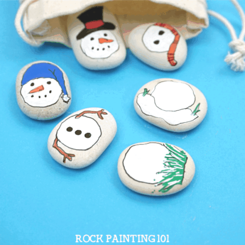 These snowman painted rocks will make amazing gifts this holiday season! Mix and match them for a fun game that kids will love to play with! #snowmanrockpainting #snowmangifts #stockingstuffers #paintedrockgifts #doyouwantobuildasnowman #rockpainting101