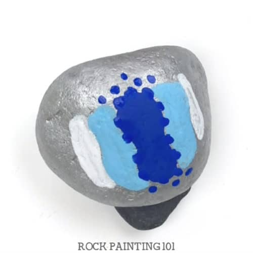 This dot painting backdrop is perfect for painted rocks. Great for adding a holiday message or making a kindness rock. #dotpainting #basecoat #background #backdrop #howtopaintrocks #rockpaintingideas #kindnessrocks #holidayrocks #tutorial #rockpainting101