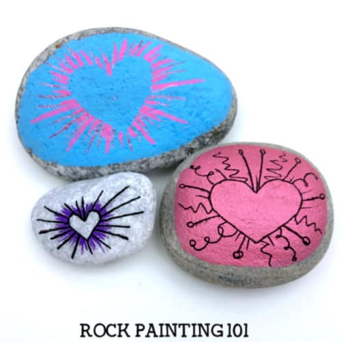 These radial heart painted rocks are perfect for giving to loved ones or hiding around your city! They make amazing kindness rocks! #rockpainting101