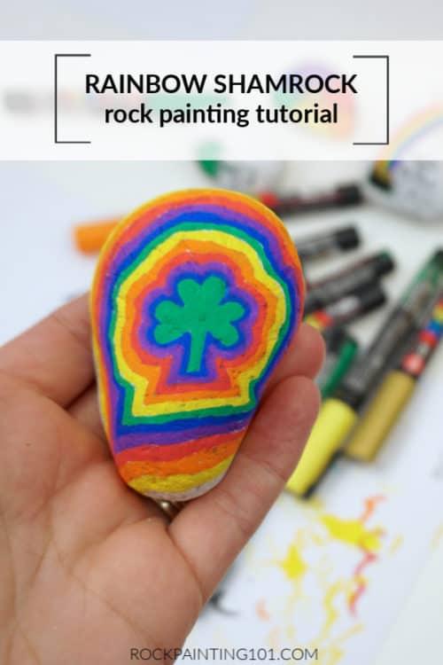 This bright rainbow shamrock rock is a fun St. Patricks Day painting idea!