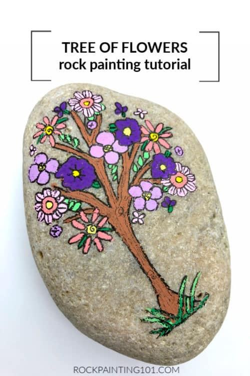 This Flower filled tree is the perfect rock to paint for spring.
