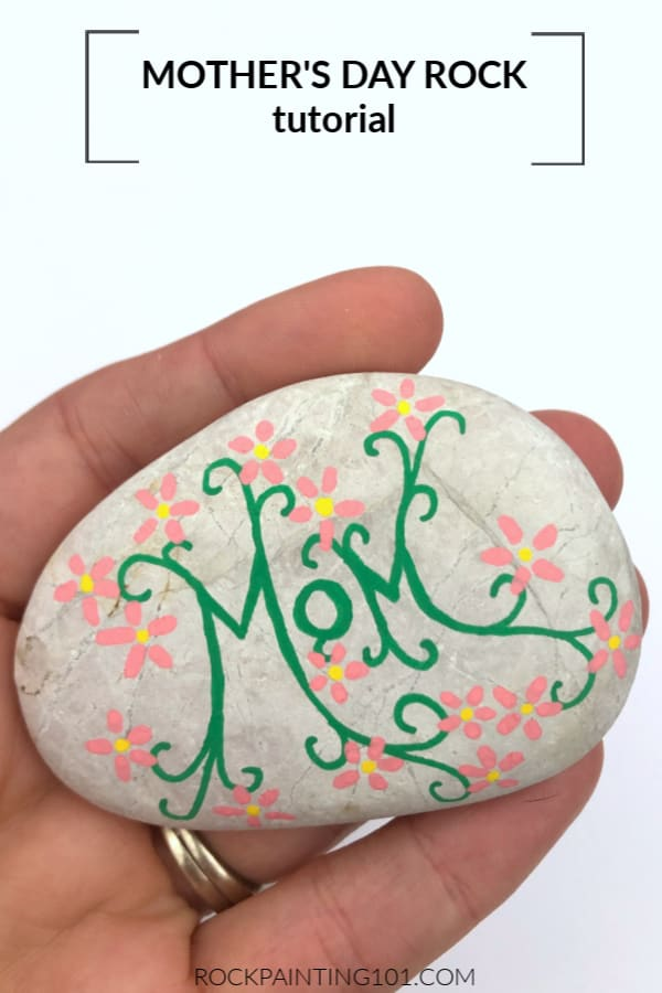 These painted vines with flowers are the perfect start to this mother's day rock design.