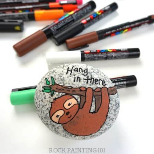 Learn how to paint this adorable sloth! This animal rock is perfect for rock painting beginners.
