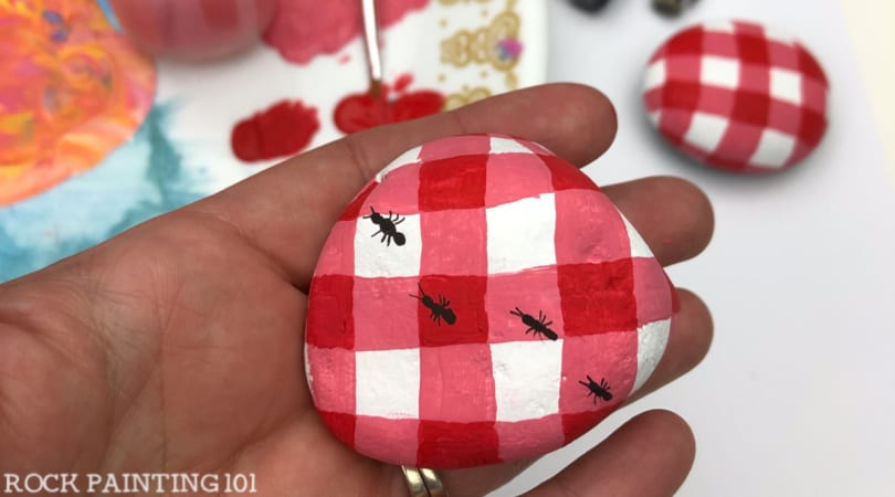 How to paint a red and white checkered pattern onto a rock