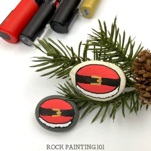 santa belly rock painting