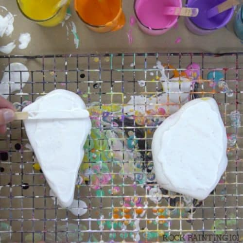 acrylic pour swipe method start with white #rockpainting101