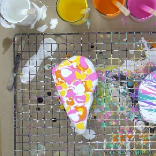 acrylic pour swipe method-add dots of paint mixed with floetrol #rockpainting101