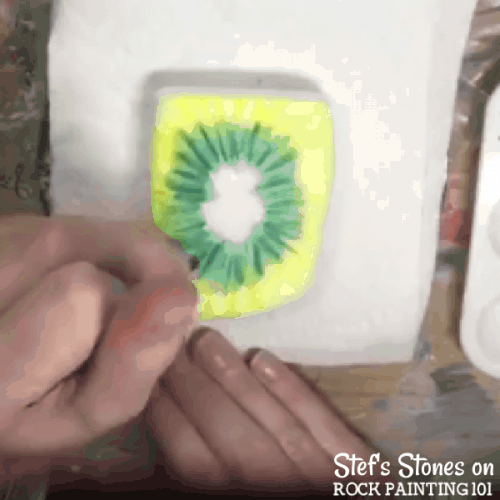 Step by step directions to painting tie dye with alcohol ink on stones.