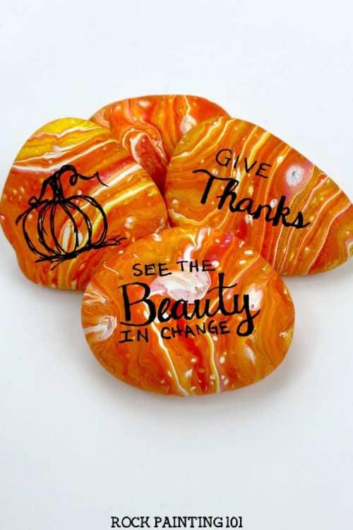 Beautiful pour painted autumn rocks